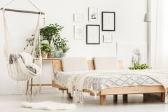 Free Wooden King-size Bed In Bedroom Stock Photos - 105956213