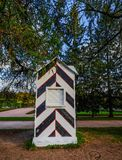 Wooden kiosk for guards in autumn garden royalty free stock photo
