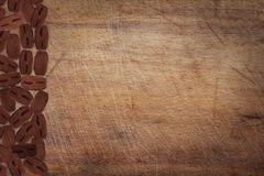 Wooden kitchen board with coffee Stock Images