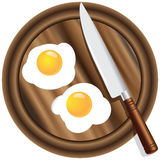 Wooden kitchen board and eggs Stock Photo
