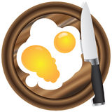 Wooden kitchen board and eggs Stock Photography