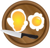 Wooden kitchen board and eggs Royalty Free Stock Photos