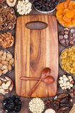 The joy of cooking. Wooden kitchen board surrounded by ingredients Royalty Free Stock Images