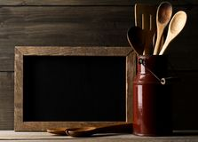 Wooden kitchen cooking tools with spoons and spatula with menu b Royalty Free Stock Image