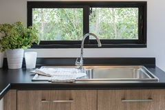 Wooden kitchen counter with black granite on top Stock Images