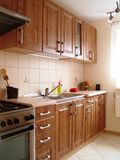 Wooden kitchen cupboards. Brown, classic, wooden kitchen cupboards royalty free stock photos