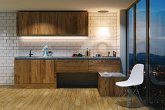 Wooden kitchen furniture in modern interior. Evening view from b Stock Photos