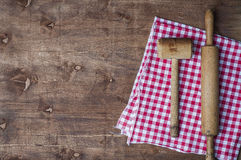 Wooden kitchen items on a red napkin, rolling pin and hammer for Stock Photos