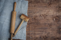 Wooden kitchen items skalka and hammer for beating meat Stock Photo