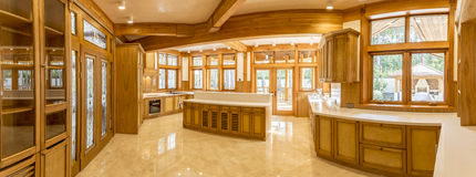 Wooden kitchen and marble floor in country house Stock Photo