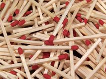 Wooden Kitchen Matches. Full frame color photograph of a jumbled pile of wooden kitchen matches Royalty Free Stock Images