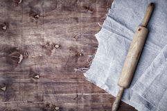 Wooden kitchen roll on a brown surface Royalty Free Stock Image