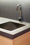 Wooden kitchen sink. Close up shot of wooden kitchen sink stock image