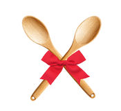 Wooden Kitchen Spoons with red bow isolated on white Royalty Free Stock Photos