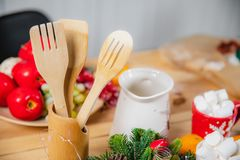 Wooden kitchen spoons and shovels wooden stand on the table surface.  royalty free stock photos