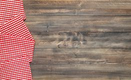 Wooden kitchen table background chequered tablecloth stock photos