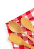 Wooden kitchen tools at cloth napkins on white Royalty Free Stock Photos