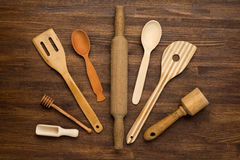 Wooden kitchen tools on vintage wooden background. Top view Royalty Free Stock Images