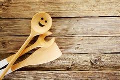 Wooden kitchen utensils on aged textured wood Stock Photo
