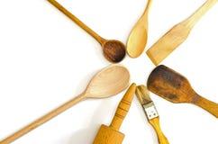 Wooden kitchen utensils arranged in star shape Stock Images