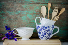 Wooden kitchen utensils and coffee cups Stock Photography