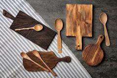 Wooden kitchen utensils. On grey background royalty free stock image