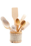 Wooden kitchen utensils isolated on white background Royalty Free Stock Photos