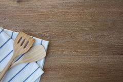 Wooden kitchen utensils and linen kitchen towels Stock Photography