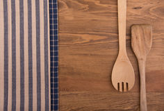 Wooden kitchen utensils and linen kitchen towels Royalty Free Stock Photo