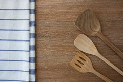 Wooden kitchen utensils and linen kitchen towels Royalty Free Stock Photos