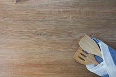 Wooden kitchen utensils and linen kitchen towels Stock Photo