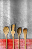 Wooden Kitchen Utensils on Metal Background Royalty Free Stock Photos