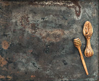 Wooden kitchen utensils on rusted metal plate background Stock Image