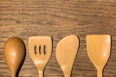 Wooden Kitchen Utensils Set in Wood Texture Background royalty free stock photo