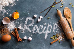 Wooden kitchen utensils with spices and recipe word Stock Photo