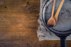 Wooden kitchen utensils on the table. Recipe book wooden spoon in a retro style on wooden table Royalty Free Stock Image