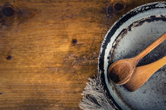 Wooden kitchen utensils on the table. Recipe book wooden spoon in a retro style on wooden table Stock Photo