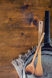 Wooden kitchen utensils on the table. Recipe book wooden spoon in a retro style on wooden table Stock Photography