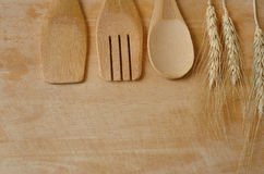 Wooden kitchen utensils and wheat on wooden Stock Photography