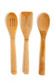 Wooden kitchen utensils on a white background Stock Photos