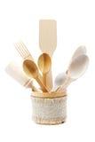 Wooden kitchen utensils on white background. Stock Photo