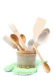 Wooden kitchen utensils on white background. Stock Images