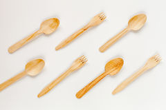 Wooden kitchen utensils on white background top view pattern Stock Photography