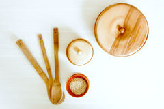 Wooden kitchen utensils on a white table. Kitchen wooden utensils on a white table. View from above with copy space Stock Image