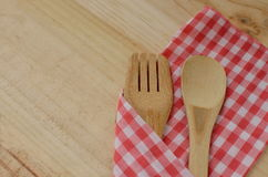 Wooden kitchen utensils on wooden background Royalty Free Stock Images