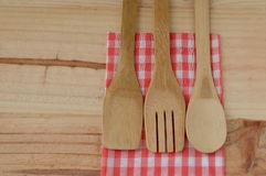 Wooden kitchen utensils on wooden background Stock Image