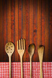 Wooden Kitchen Utensils on Wooden Background Royalty Free Stock Photo