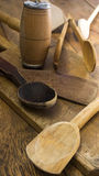 Wooden kitchen utensils on wooden chopping board. High resolution image Royalty Free Stock Photos