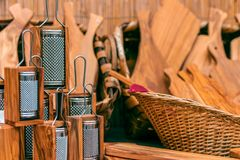Wooden kitchen utensils. Wooden grater and other wooden tools for the kitchen in the background. royalty free stock photos