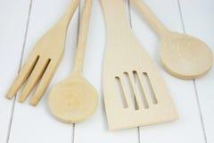 Wooden kitchen utensils on wooden surface Stock Photo